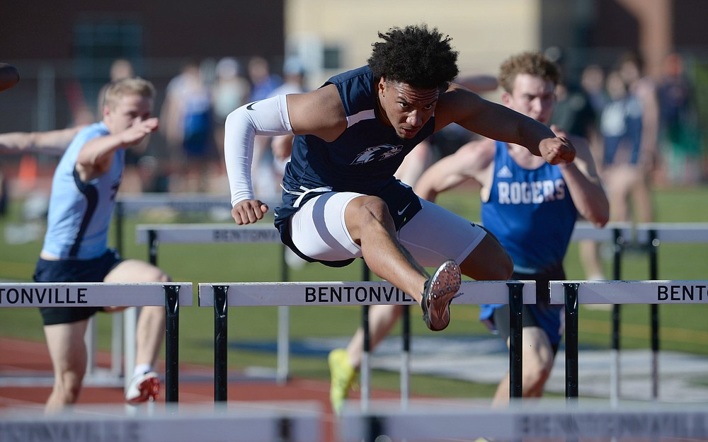 AJ Moss of Bentonville West competes in the 110-meter hurdles Friday during the 6A-West Conference Track and Field Meet at the Tiger Athletic Complex in Bentonville. More photos are available at arkansasonline.com/51track6a/ (NWA Democrat-Gazette/Andy Shupe)