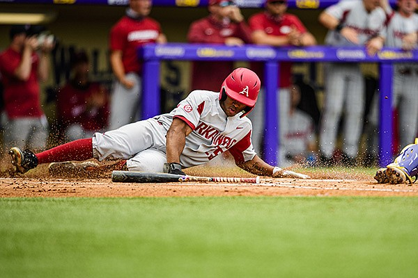 Arkansas' Christian Franklin slides into home plate during a game against LSU on Saturday, May 1, 2021, in Baton Rouge, La. (Photo by Beau Brune/LSU Athletics, via SEC pool)