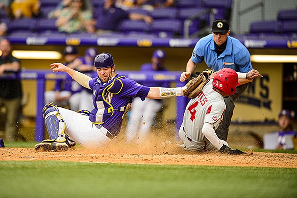 Arkansas' Jalen Battles (4) slides safely into home plate ahead of a tag from LSU catcher Jake Wyeth during a game Saturday, May 1, 2021, in Baton Rouge, La. (Photo by Beau Brune/LSU Athletics, via SEC pool)