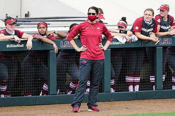 Arkansas softball coach Courtney Deifel stands in front of the dugout during a game against LSU on Monday, May 3, 2021, in Baton Rouge, La. (Photo by Rebecca Warren, LSU Athletics, via SEC pool)