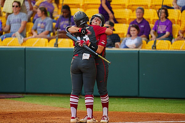 Arkansas' Kayla Green (13) is congratulated by Aly Manzo after Green hit a home run during a game against LSU on Monday, May 3, 2021, in Baton Rouge, La. (Photo by Rebecca Warren, LSU Athletics, via SEC pool)