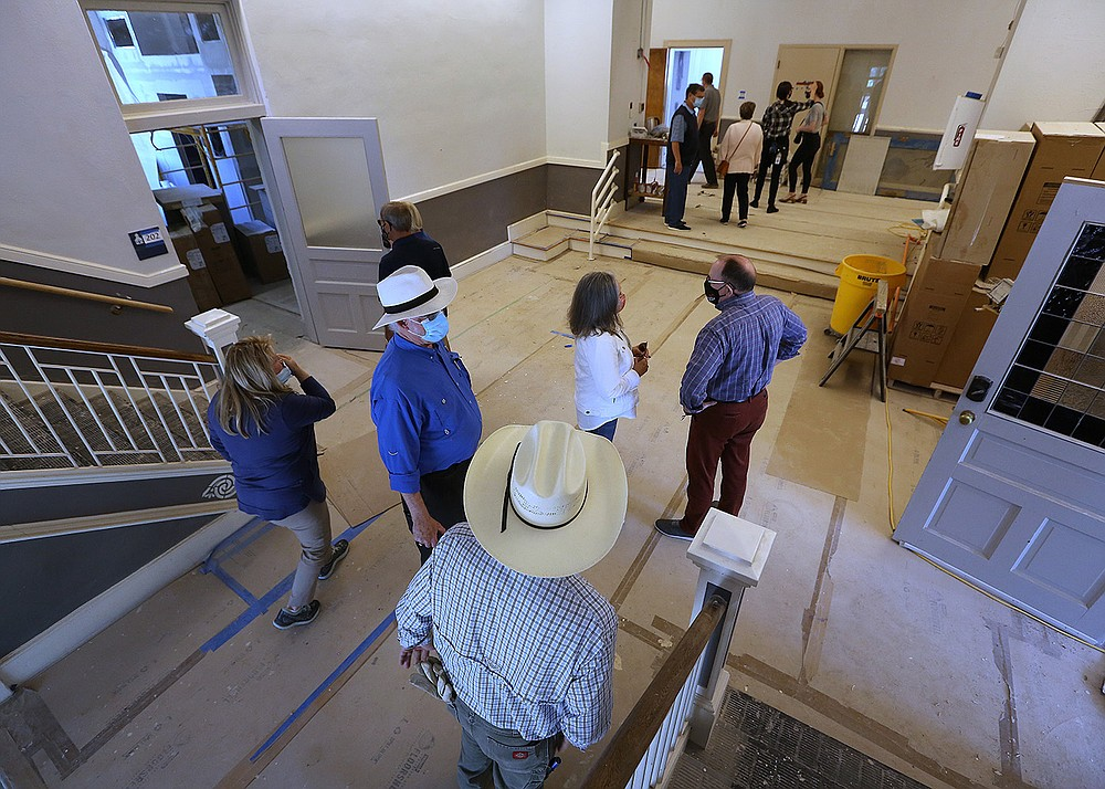 Visitors tour the Woodruff School after the announcement of Preserve Arkansas' 2021 Most Endangered Places list during a news conference outside the building Wednesday in Little Rock. The Woodruff School was included in the 2017 Most Endangered Places list. It is being rehabilitated with federal and state historic tax credits, and will offer apartments and restaurant space. (Arkansas Democrat-Gazette/Thomas Metthe)