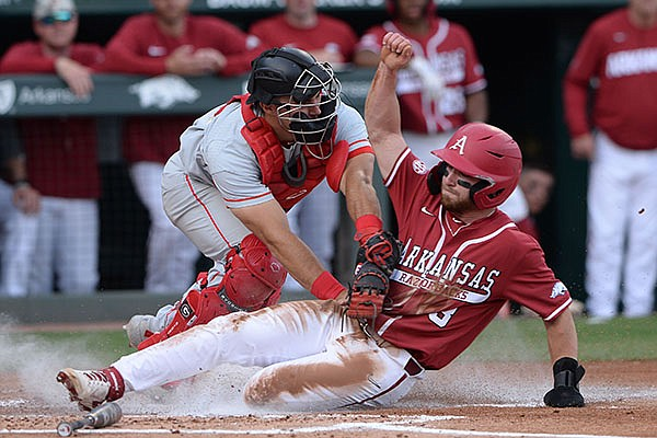 Arkansas left fielder Zack Gregory (3) is tagged out Saturday, May 8, 2021, by Georgia catcher Corey Collins while attempting to score on a fly ball out to center field during the first inning of play against Georgia at Baum-Walker Stadium in Fayetteville.