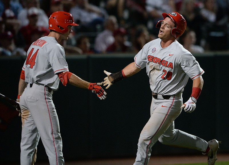 Georgia first baseman Chaney Rogers (20) is congratulated Saturday, May 8, 2021, by center fielder Ben Anderson during the ninth inning of play against Georgia at Baum-Walker Stadium in Fayetteville. Visit nwaonline.com/210509Daily/ for today's photo gallery. .(NWA Democrat-Gazette/Andy Shupe)