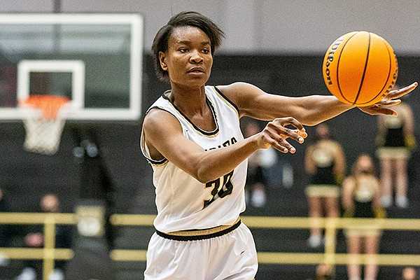 Bentonville's Maryam Dauda passes the ball during a game against Rogers on Tuesday, Jan. 19, 2021, in Bentonville. (Photo by David Beach, Special to the NWA Democrat-Gazette)