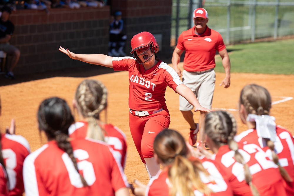 Savannah Snow of Cabot celebrates after hitting a home run to lead the defending state champions to an 11-9 victory over Fort Smith Southside in a Class 6A state softball tournament quarterfinal Friday in Cabot. Snow went 2 for 4 with a home run, a double, 2 runs and 3 RBI for the Lady Panthers, who move on to play Conway in a semifinal today. More photos at arkansasonline.com/515girls6a1/.  (Arkansas Democrat-Gazette/Justin Cunningham)