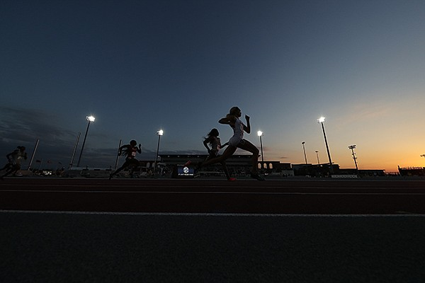 Runners race during the SEC Outdoor Track and Field Championships on Friday, May 14, 2021, in College Station, Texas. (SEC pool photo)