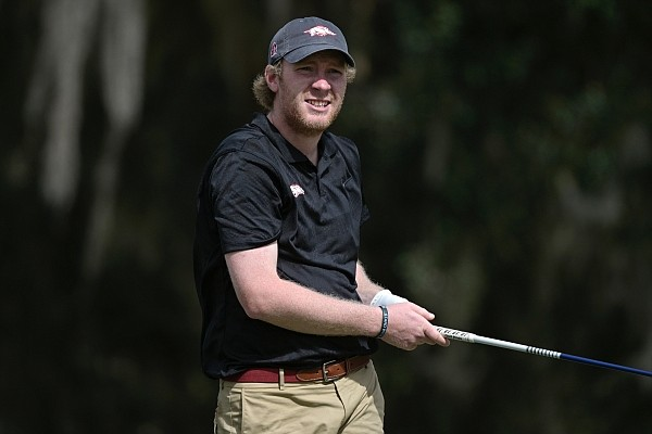 William Buhl, of Arkansas, watches his tee shot on the 16th hole during an NCAA golf tournament on Friday, Feb. 12, 2021, in Gainesville, Fla. (AP Photo/Phelan M. Ebenhack)