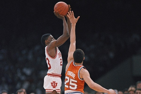 Syracuse's Howard Triche (25) tries to stop Indiana's Keith Smart from making a shot in the final moments of the NCAA Championship game in New Orleans, La., in 1987. Indiana won the last of its three championships under coach Bobby Knight in 1987, and it did so in dramatic fashion – with Keith Smart connecting on a baseline jumper in the closing seconds to give the Hoosiers a 74-73 win over Syracuse. (AP Photo/Susan Ragan, File)
