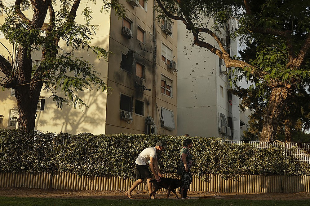 A residential building in Ashkelon, Israel, shows the damage Friday that was inflicted by a rocket fired from the Gaza Strip last week. Twelve people were killed in Israel, all but one of them civilians, including a 5-year-old boy and a 16-year-old girl. (AP/Maya Alleruzzo)