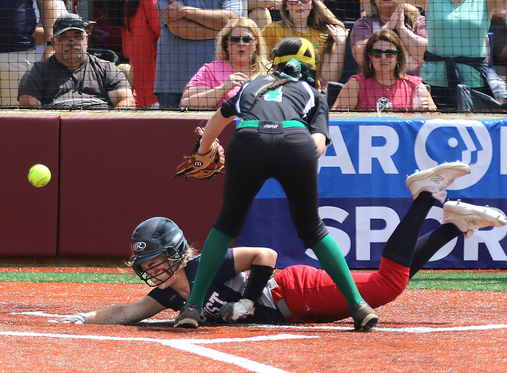 Baptist Prep's Karis Turner slides home past Hoxie pitcher Ashten Wallace during the fifth inning of the Lady Eagles' 9-1 victory over Hoxie in the Class 3A state championship game Saturday. (Arkansas Democrat-Gazette/Thomas Metthe)