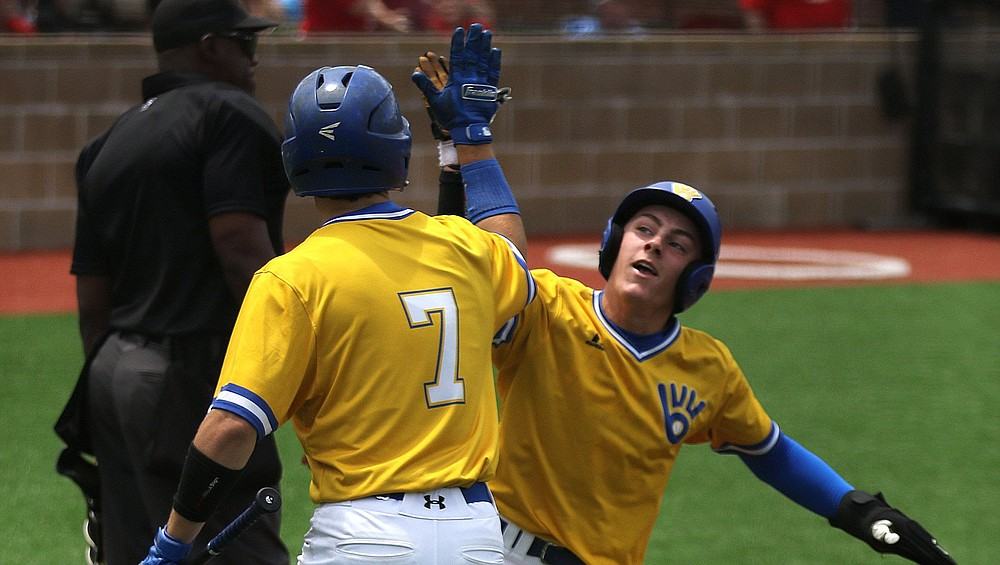 Valley View's Slade Caldwell (right) is congratulated by  teammate Carter Saulsbury during an 8-1 victory over Magnolia in the Class 4A  baseball championship game Saturday at Benton. See more photos at arkansasonline.com/523baseball. (Arkansas Democrat-Gazette/Justin Cunningham)