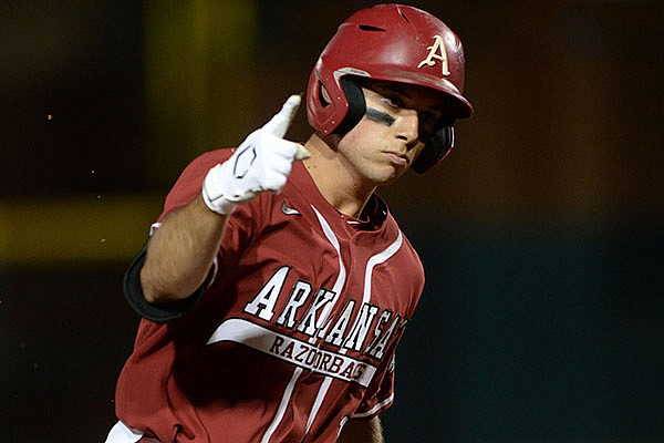 Arkansas second baseman Robert Moore runs the bases after hitting a home run during a game against Florida on Friday, May 21, 2021, in Fayetteville.