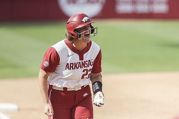 Linnie Malkin celebrates a home run while running the bases during an NCAA regional game against Stanford on Sunday, May 23, 2021, in Fayetteville.