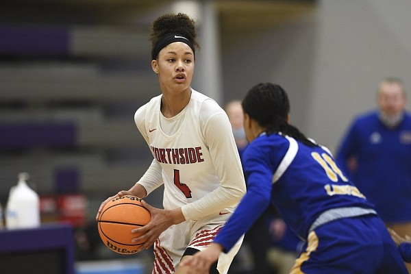 Fort Smith Northside guard Jersey Wolfenbarger looks to make a play against North Little Rock during the state tournament at Fayetteville High School.