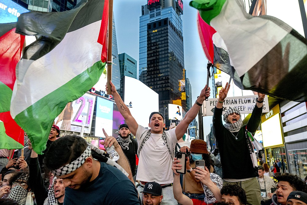Pro-Palestinian supporters are shown during a demonstration in New York's Times Square on May 20. The supporters are protesting an 11-day war between Israel and Hamas that caused widespread destruction in the Gaza Strip. (AP/Craig Ruttle)