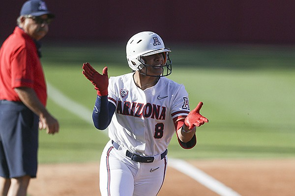 Arizona catcher Dejah Mulipola (8) runs toward home plate during an NCAA super regional game against Arkansas on Friday, May 28, 2021, in Fayetteville.