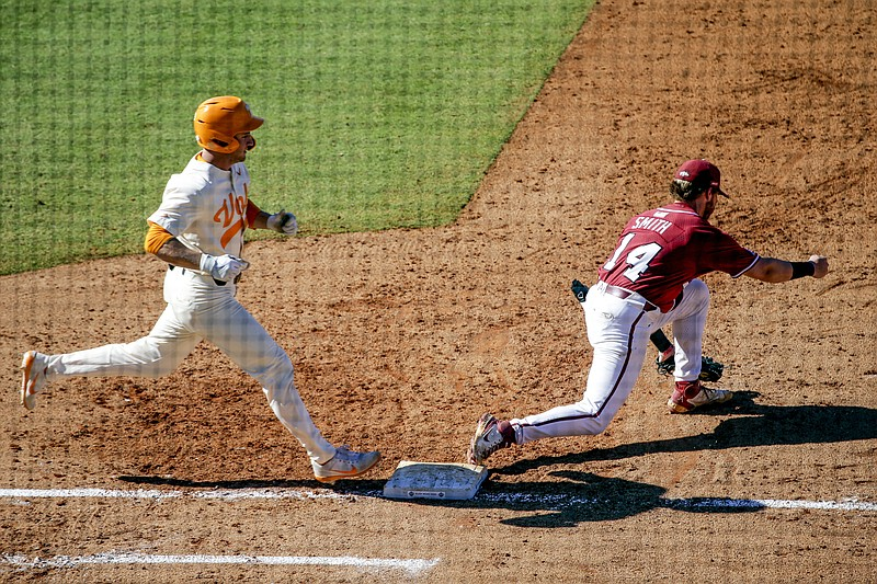 Arkansas first baseman Cullen Smith (14) gets the out on Tennessee's Evan Russell (6) in the ninth inning of an NCAA college baseball championship game during the Southeastern Conference tournament Sunday, May 30, 2021, in Hoover, Ala. (AP Photo/Butch Dill)