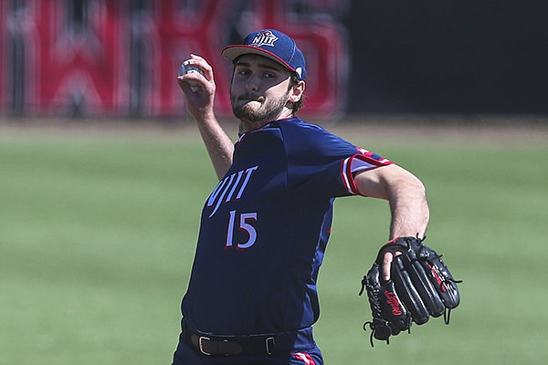 NJIT's Tyler Stafflinger (15) pitches during an NCAA baseball game against Hartford on Saturday, March 27, 2021, in Hartford, Conn. (AP Photo/Stew Milne)