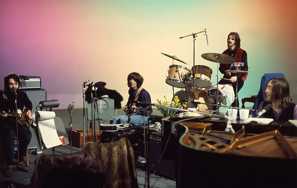 """Come together: Paul McCartney, George Harrison, Ringo Starr and John Lennon are shown in a scene from Peter Jackson's no-doubt lovingly restored """"The Beatles: Get Back."""""""
