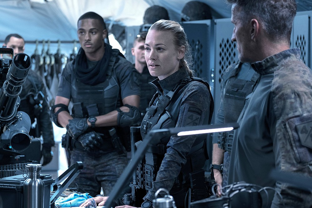"""In the Amazon Prime movie """"The Tomorrow War,"""" Australian Yvonne Strahovski stars as brilliant scientist Romeo Command, recruited by time travelers to jump 30 years into the future."""