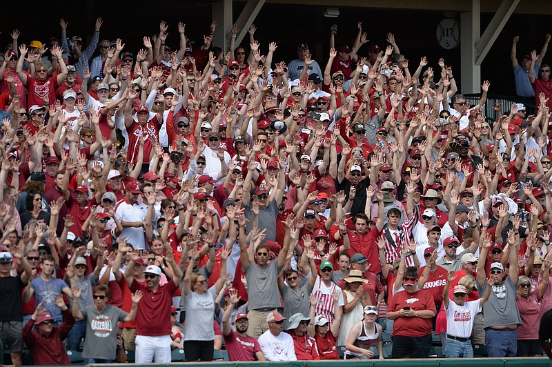 Fans at Baum-Walker Stadium call the Hogs during the fourth inning of Arkansas' victory over NJIT on Friday in the first game of the NCAA Tournament's Fayetteville Regional. Attendance for the game was listed at 11,084. (NWA Democrat-Gazette/Andy Shupe)