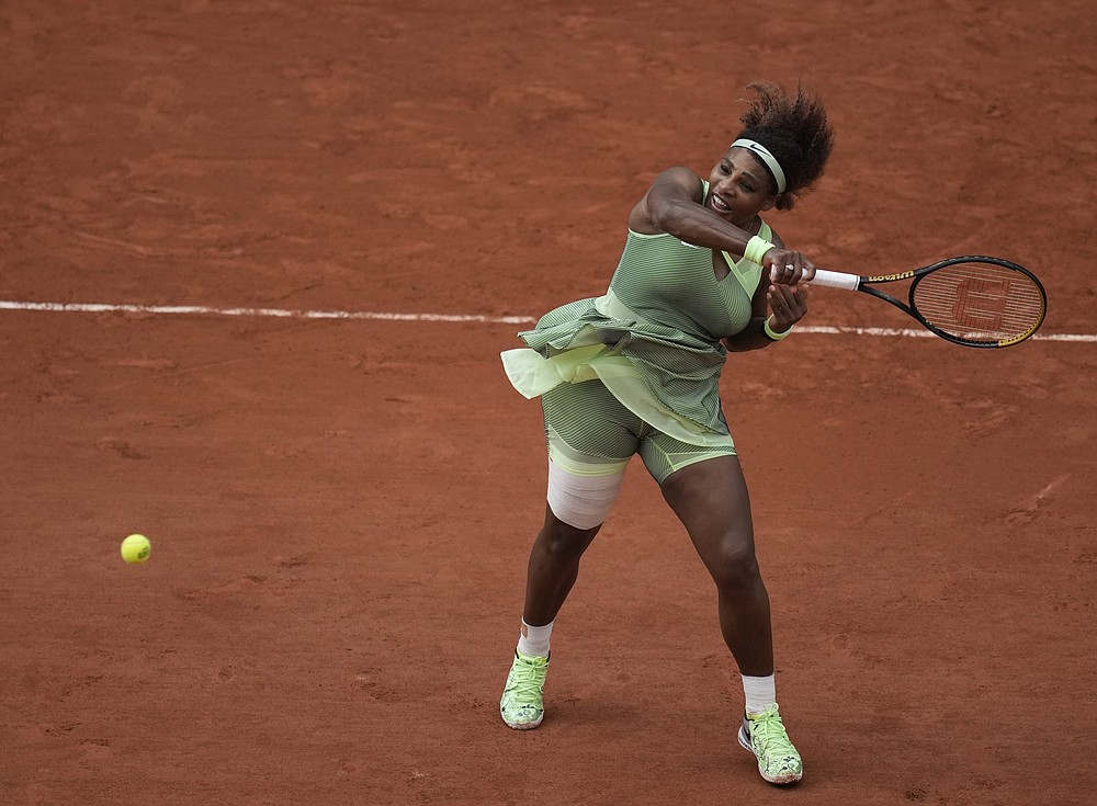 Serena Williams plays a return to Danielle Collins during their French Open third-round match Friday at Roland Garros in Paris. Williams rallied from a 4-1 deficit in the second set to win 6-4, 6-4. More photos at arkansasonline.com/65open/ (AP/Christophe Ena)