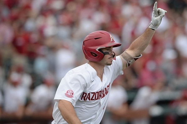 Arkansas left fielder Braydon Webb celebrates Friday, June 4, 2021, after hitting a two-run home run during the third inning of the Razorbacks' 13-8 win over New Jersey Institute of Technology in the first game of the NCAA Fayetteville Regional at Baum-Walker Stadium in Fayetteville. Visit nwaonline.com/210605Daily/ for the photo gallery.