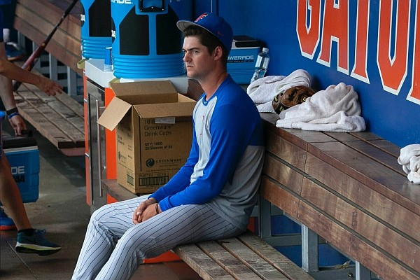 Florida's Tommy Mace (47) sits in the dugout following to the Gators 19-1 loss to South Alabama in an NCAA regional tournament college baseball game against South Alabama at Florida Ballpark, Saturday, June 5, 2021, in Gainesville, Fla. (Cyndi Chambers/Ocala Star-Banner via AP)