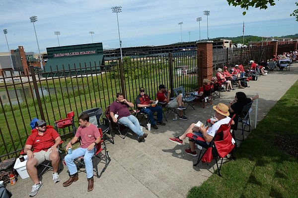 University of Arkansas baseball fans visit Friday, June 4, 2021, while lining up along Razorback Road hours before the gates open to see the Razorbacks' game with New Jersey Institute of Technology in the first round of the Fayetteville Regional at Baum-Walker Stadium in Fayetteville.