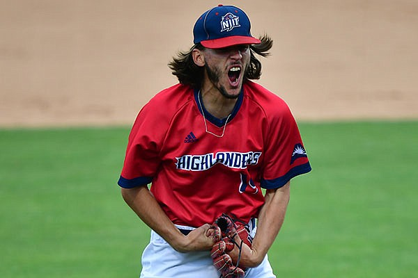 NJIT pitcher Jake Rappaport celebrates after recording the final out of an NCAA regional game against Northeastern on Saturday, June 5, 2021, in Fayetteville.