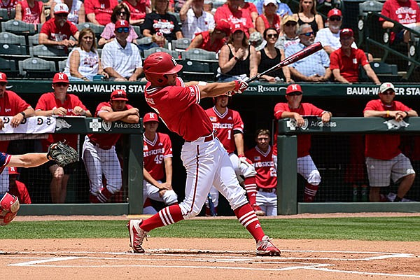Nebraska outfielder Joe Acker hits a triple during the first inning of an NCAA regional game against NJIT on Sunday, June 6, 2021, in Fayetteville.