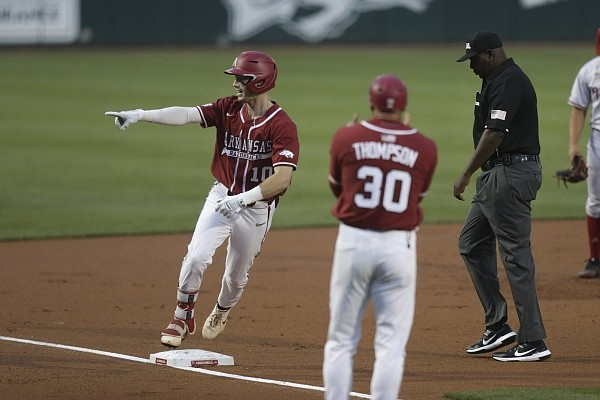 Arkansas infielder Matt Goodheart (10) runs home for a score, Saturday, June 5, 2021 during the first inning in the second game of the NCAA Fayetteville Regional at Baum-Walker Stadium in Fayetteville. Check out nwaonline.com/210606Daily/ for the photo gallery.