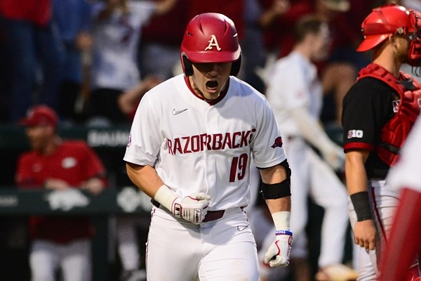 Arkansas' Charlie Welch celebrates after hitting a home run in the 8th inning of the Razorbacks' 6-2 win over Nebraska on Monday, June 7, 2021 in the Fayetteville Regional title game.