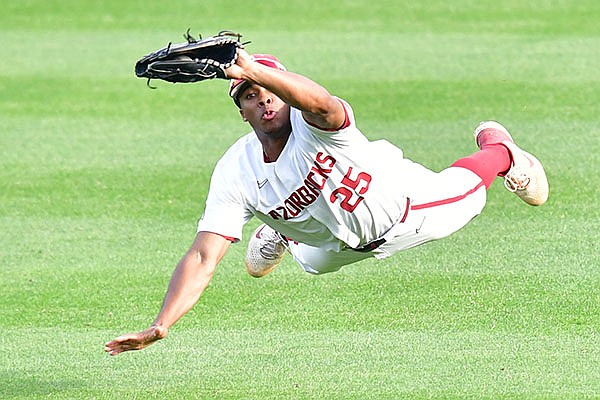 Arkansas center fielder Christian Franklin dives to make a catch during an NCAA regional game against Nebraska on Monday, June 7, 2021, in Fayetteville.