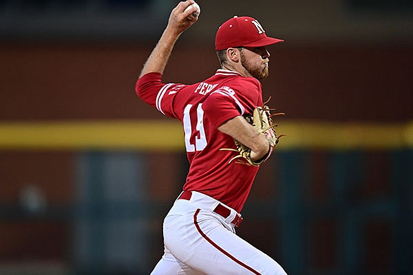 Nebraska pitcher Kyle Perry throws during an NCAA regional game against Arkansas on Sunday, June 6, 2021, in Fayetteville.