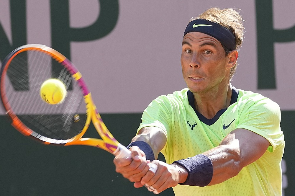 Spain's Rafael Nadal plays a return to Italy's Jannik Sinner during their fourth round match on day 9, of the French Open tennis tournament at Roland Garros in Paris, France, Monday, June 7, 2021. (AP Photo/Michel Euler)