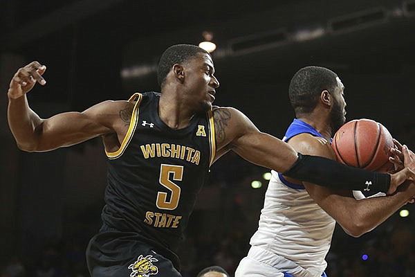 Wichita State forward Trey Wade (5) goes for a rebound against Tulsa forward Jeriah Horne (41) in the first half of an NCAA college basketball game in Tulsa, Okla., Saturday, Feb. 1, 2020. (AP Photo/Joey Johnson)