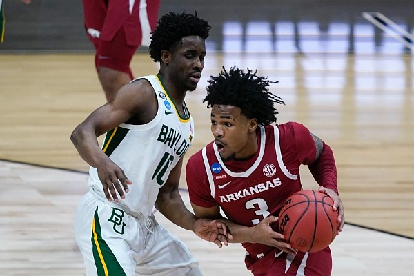 Arkansas guard Desi Sills (3) drives past Baylor guard Adam Flagler (10) during the first half of an Elite 8 game in the NCAA men's college basketball tournament at Lucas Oil Stadium, Monday, March 29, 2021, in Indianapolis. (AP Photo/Michael Conroy)