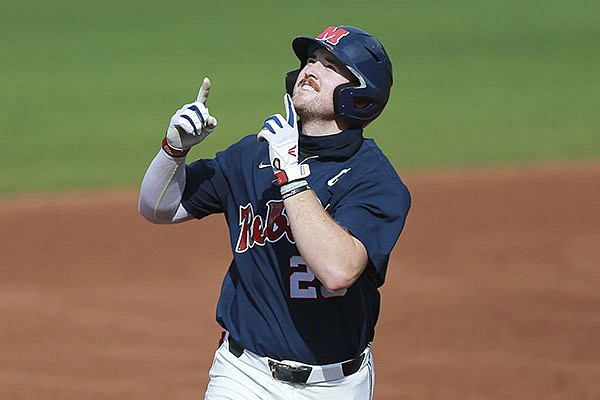 Ole Miss' Tim Elko points skyward as he runs around the bases after hitting his second home run against Southern Miss during an NCAA college baseball tournament regional game Monday, June 7, 2021, in Oxford, Miss. (Thomas Wells/The Northeast Mississippi Daily Journal via AP)