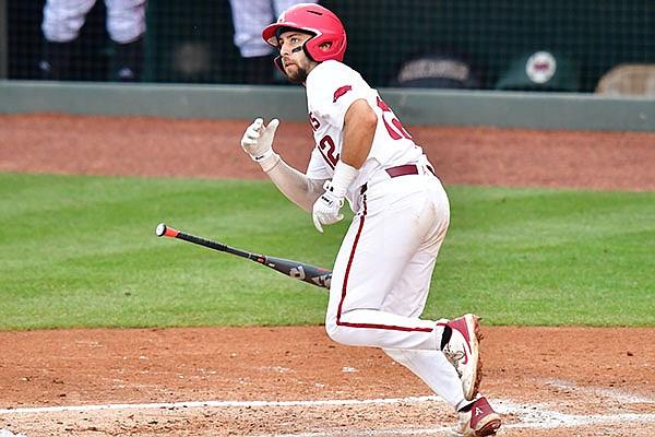 Arkansas catcher Casey Opitz hits a home run during an NCAA regional game against Nebraska on Monday, June 7, 2021, in Fayetteville.