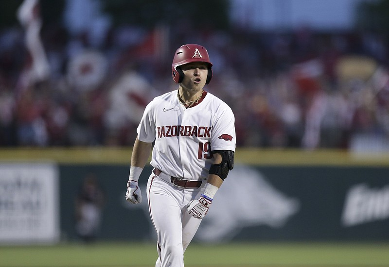 Arkansas catcher Charlie Welch (19) runs home following his home-run, Monday, June 7, 2021 in the eighth inning of the NCAA Fayetteville Regional at Baum-Walker Stadium in Fayetteville. Check out nwaonline.com/210608Daily/ for today's photo gallery. .(NWA Democrat-Gazette/Charlie Kaijo)