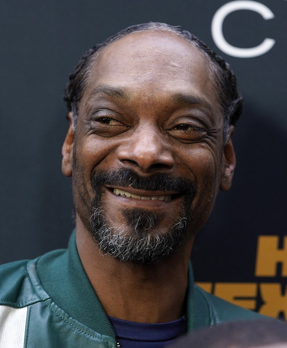 """Snoop Dogg, a cast member in the film """"The House Next Door: Meet The Blacks 2,"""" poses at the premiere of the film at Regal L.A. Live, Monday, June 7, 2021, in Los Angeles. (AP Photo/Chris Pizzello)"""