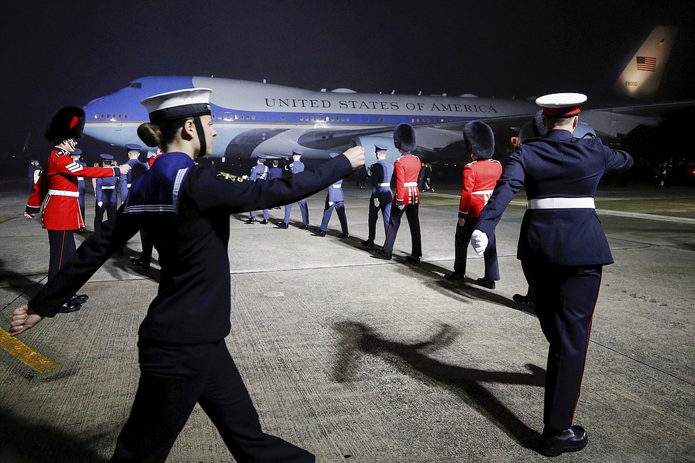 Military personnel march to welcome U.S. President Joe Biden and first lady Jill Biden as they arrive Wednesday on Air Force One at Cornwall Airport Newquay near Newquay, England. More photos at arkansasonline.com/610trip/. (AP/Phil Noble)