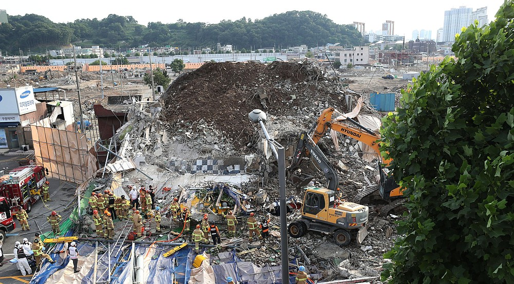 Firefighters search for survivors Wednesday after a building collapsed in Gwangju, South Korea. (AP/Yonhap/Chung Hoi-sung)