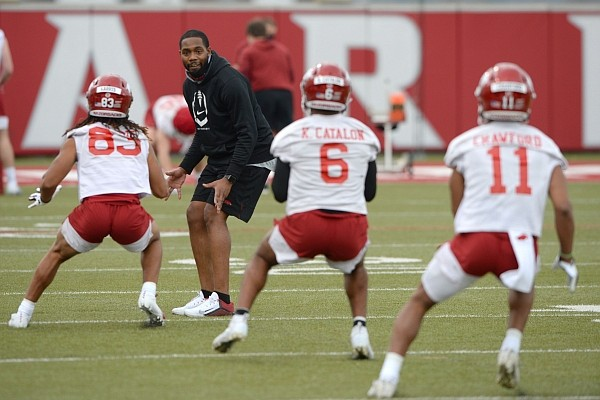 Arkansas receivers coach Kenny Guiton directs his players Tuesday, March 9, 2021, during practice in Fayetteville. Visit nwaonline.com/210310Daily/ for the photo gallery.