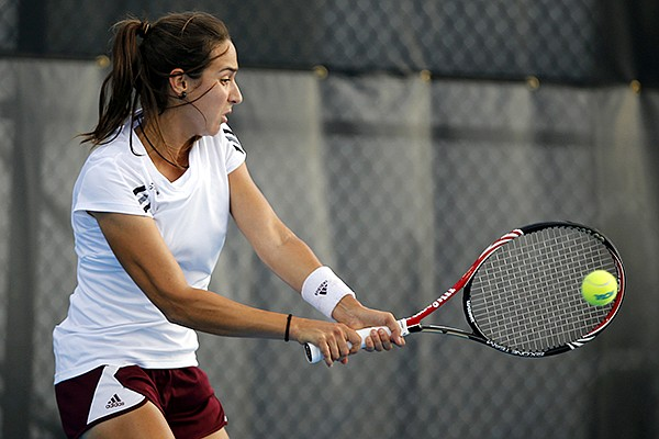 Texas A&M's Cristina Sanchez-Quintanar returns a shot against Stanford's Nicole Gibbs during the NCAA division 1 women's team tennis championship at the Khan Outdoor Tennis Complex Tuesday, May 21, 2013, in Urbana, Ill. (AP Photo/Stephen Haas)
