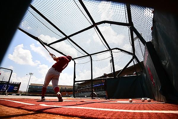 Arkansas second baseman Robert Moore takes batting practice Thursday, June 10, 2021, in Fayetteville.
