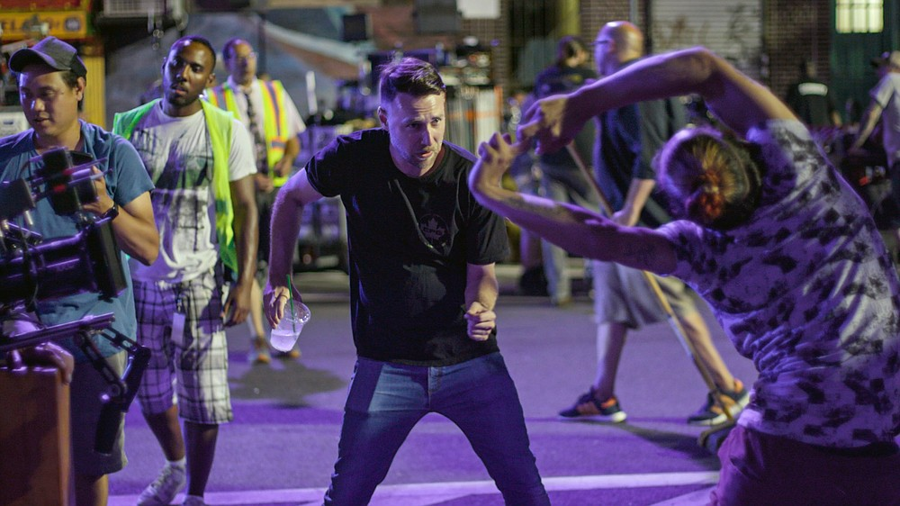 """One and two and three and four: Choreographer Christopher Scott works with dancers on a large scale number the set of """"In the Heights."""""""