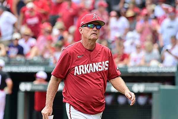 Arkansas coach Dave Van Horn walks toward the dugout during an NCAA super regional game against North Carolina State on Saturday, June 12, 2021, in Fayetteville.